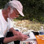 Joseph Orr paints on location near his studio in Osage Beach, MO